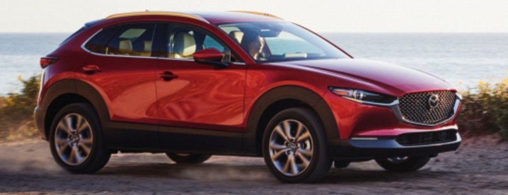 A 2021 MAzda CX-30 driving on a road