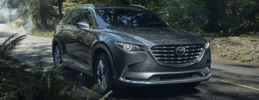 A 2021 Mazda CX-9 driving on a road
