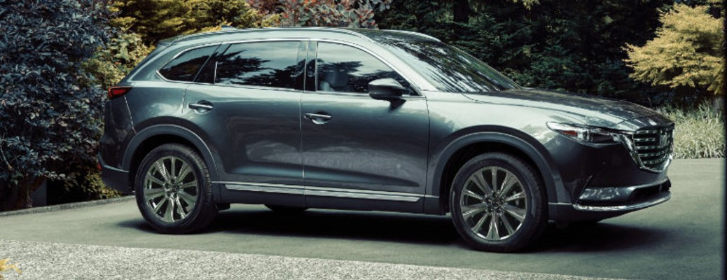 A 2021 Mazda Cx-9 parked outside near some trees