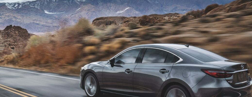 gray 2021 Mazda6 on a freeway. Is the 2021 Mazda6 safe?