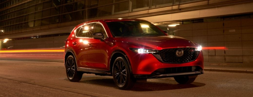 A red-colored 2022 Mazda CX-5 on road at night