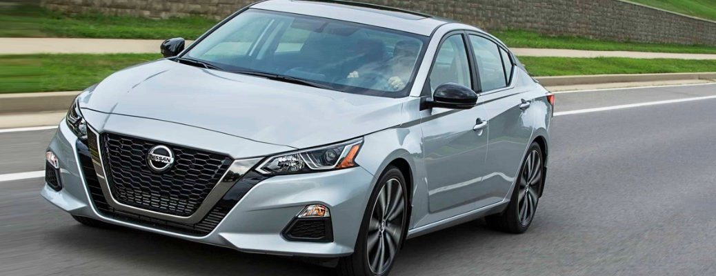 Silver 2019 Nissan Altima Driving On Residential Road