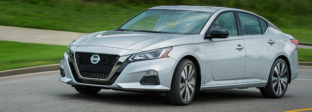Silver 2020 Nissan Altima driving on a curvy road