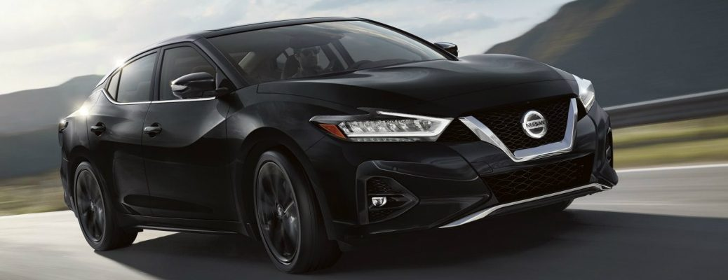 Passenger's side front angle view of black 2020 Nissan Maxima