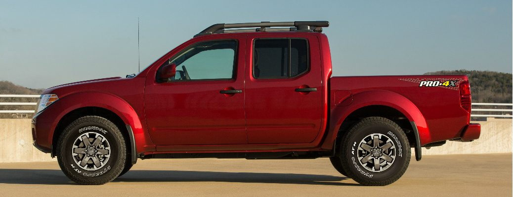 Side view of red 2020 Nissan Frontier