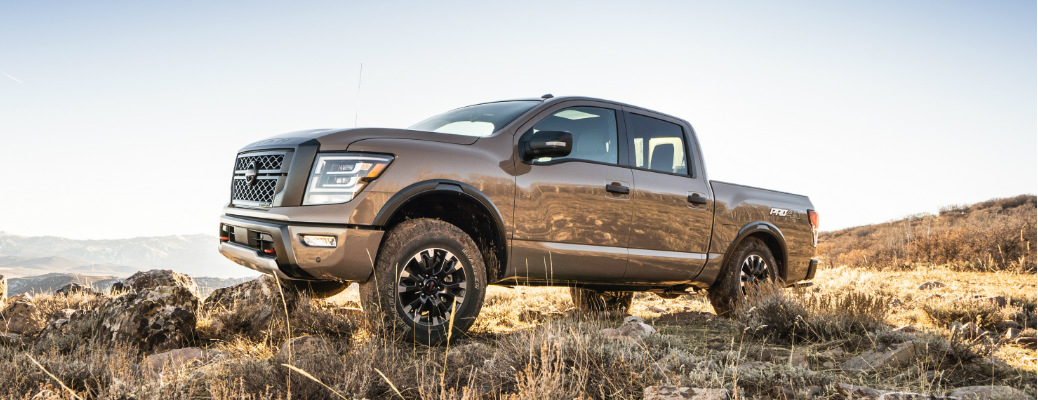Brown 2020 Nissan TITAN parked on a rocky hill