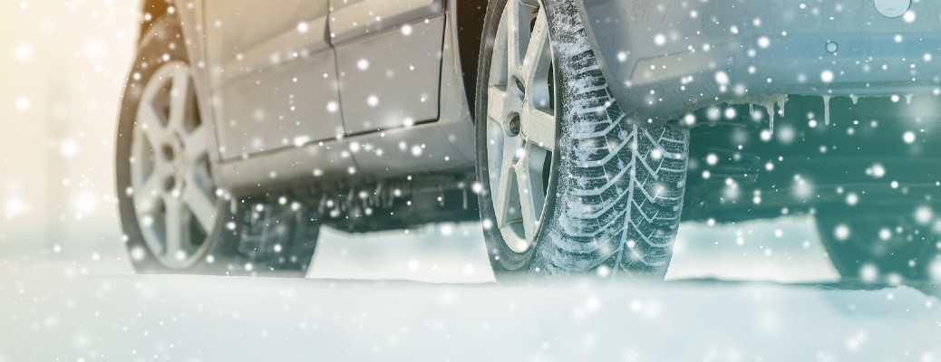 image of tires driving in snow