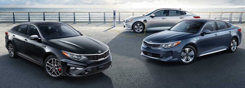 Three 2019 Kia Optima models parked near each other