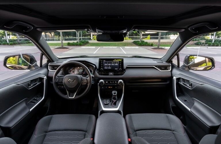 A photo of the driver's cockpit and dashboard in the 2021 Toyota RAV4 Prime.