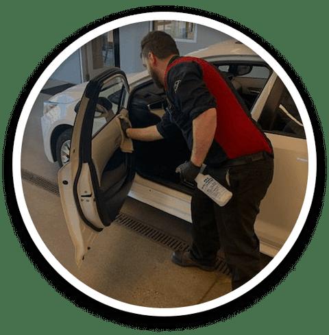 Employee Sanitizing Vehicle