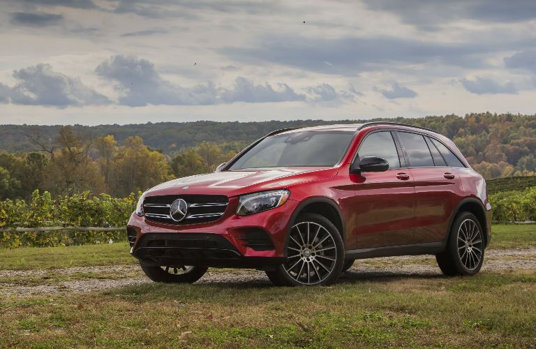 A front left quarter photo of the 2018 Mercedes-Benz GLC parked in a field.