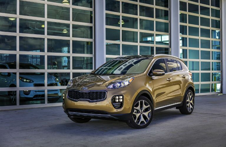2019 Kia Sportage parked in front of a modern building