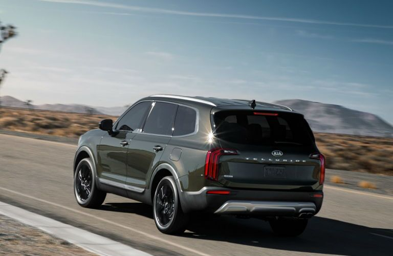Green 2020 Kia Telluride Rear Exterior on Desert Highway