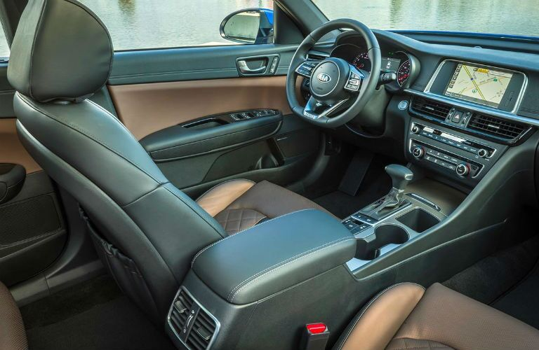 Dashboard and brown and grey front seats in 2019 Kia Optima