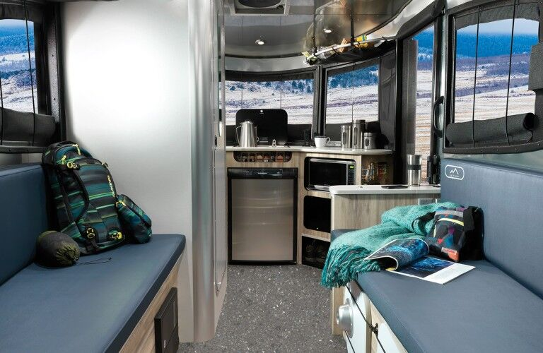 The interior view of a 2020 Airstream Basecamp model with items scattered about.
