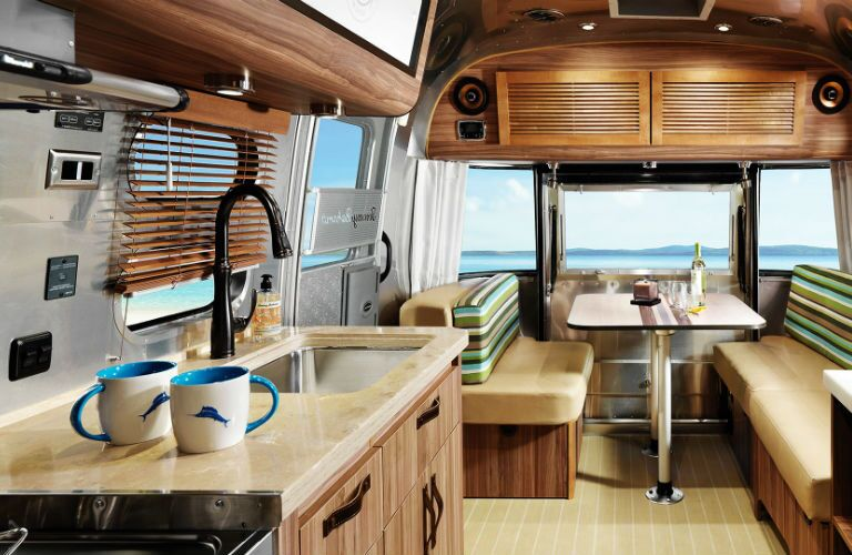 An interior photo of the living space in the 2019 Airstream Tommy Bahama.