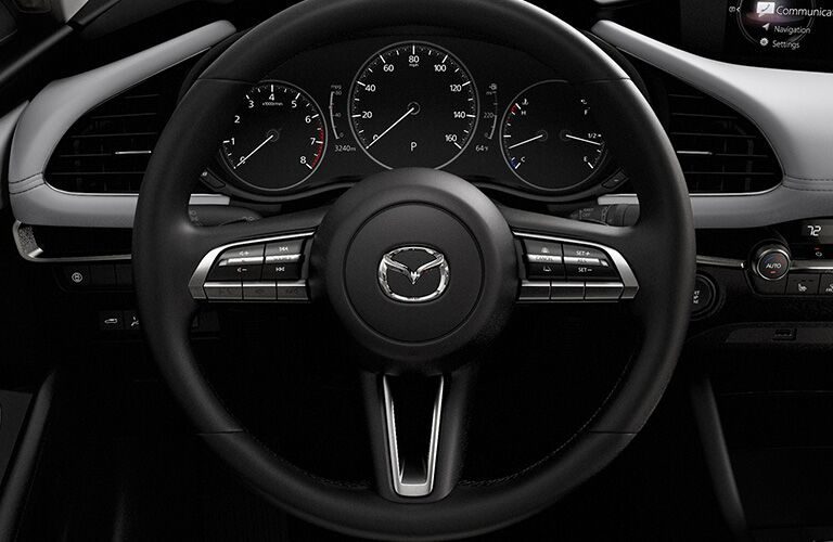 Interior view of the steering wheel inside a 2020 Mazda3 Hatchback