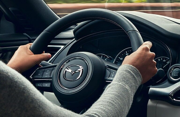 2020 Mazda CX-9 interior steering wheel woman hands on wheel