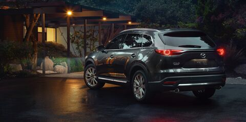 Mazda CX-9 in front of home at night