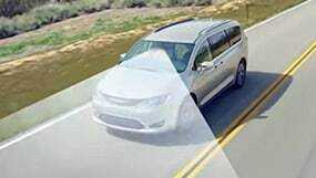 Chrysler Pacifica driving down the road