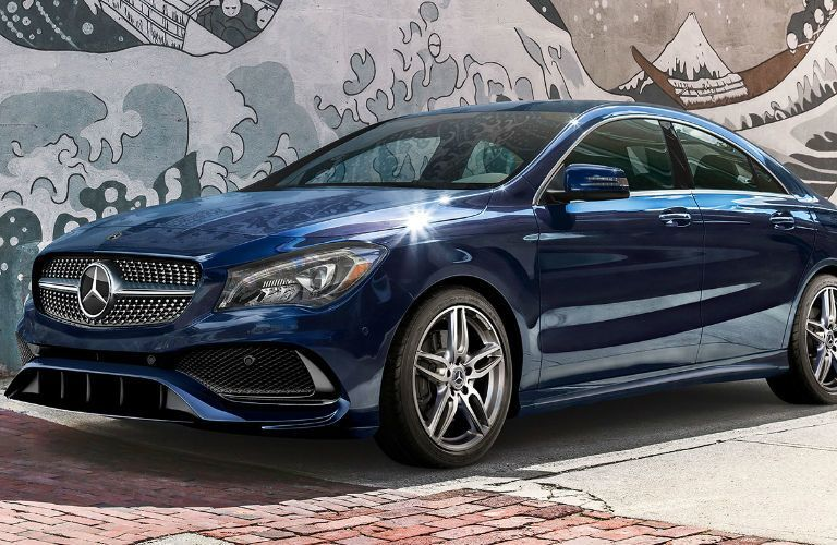 2019 Mercedes-Benz CLA Coupe parked in front of a wall with a painting of a wave of water