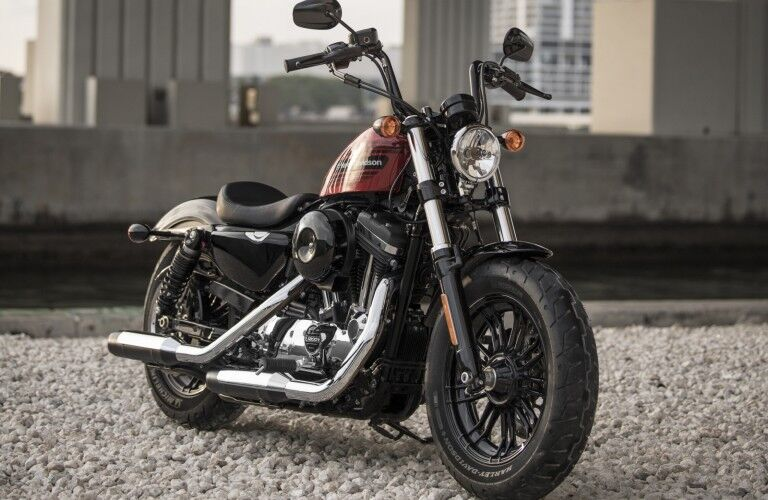The front image of a black and red 2018 Harley-Davidson 48-Special model parked in a car park.