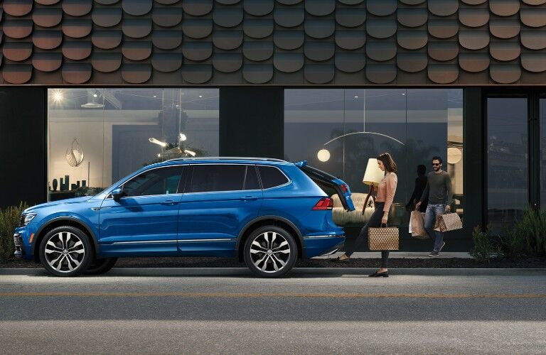 Woman operating power liftgate of 2020 VW Tiguan