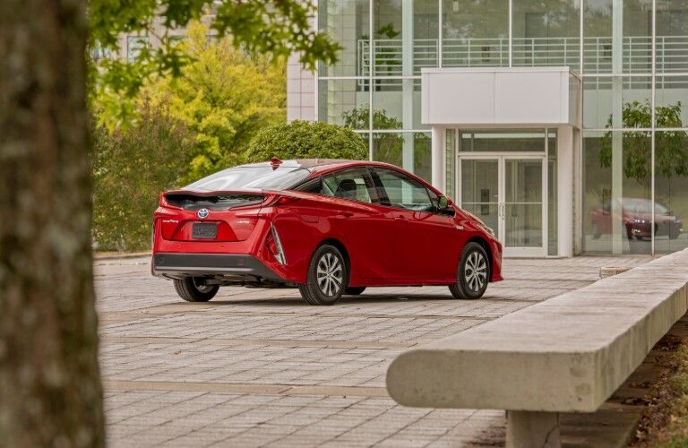 rear of red 2021 Toyota Prius parked near building