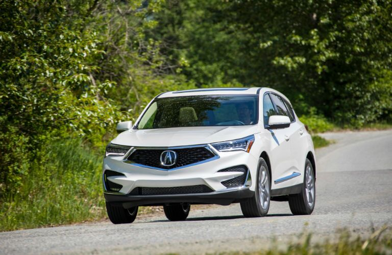 A head-on photo of the 2020 Acura RDX driving on the road.