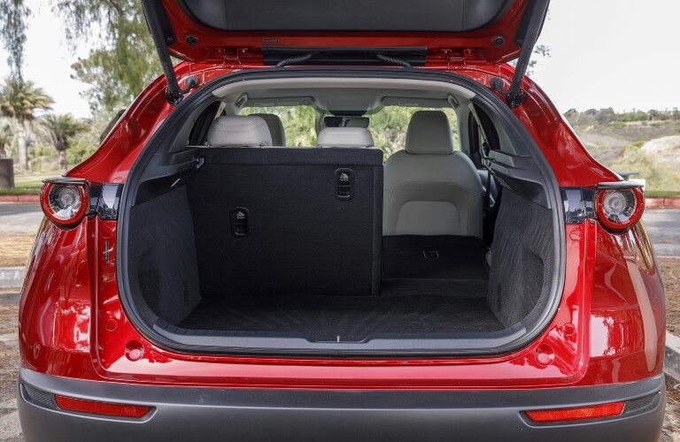 View of the rear cargo area available inside a red 2020 Mazda CX-30