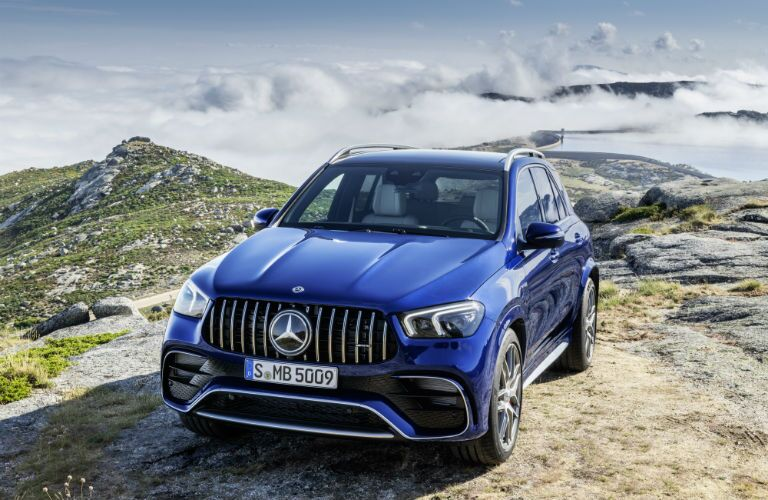 2021 MB GLE exterior front fascia driver side on mountain with clouds