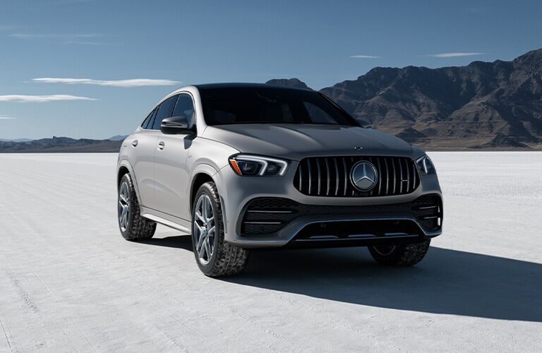 2021 M GLE Coupe exterior front fascia passenger side in snow with mountain background
