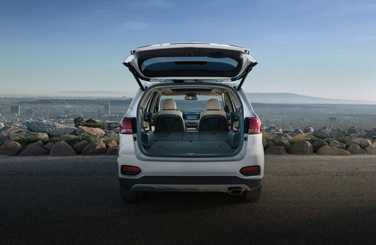 Exterior view of the rear of a silver 2020 Kia Sorento with the rear hatch open