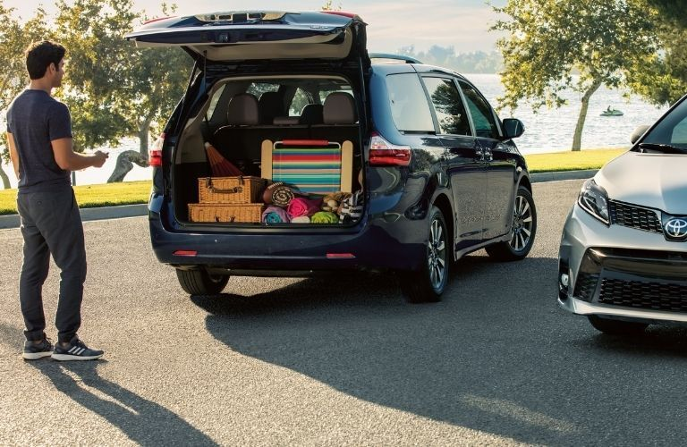 man standing near rear cargo area of 2020 Toyota Sienna
