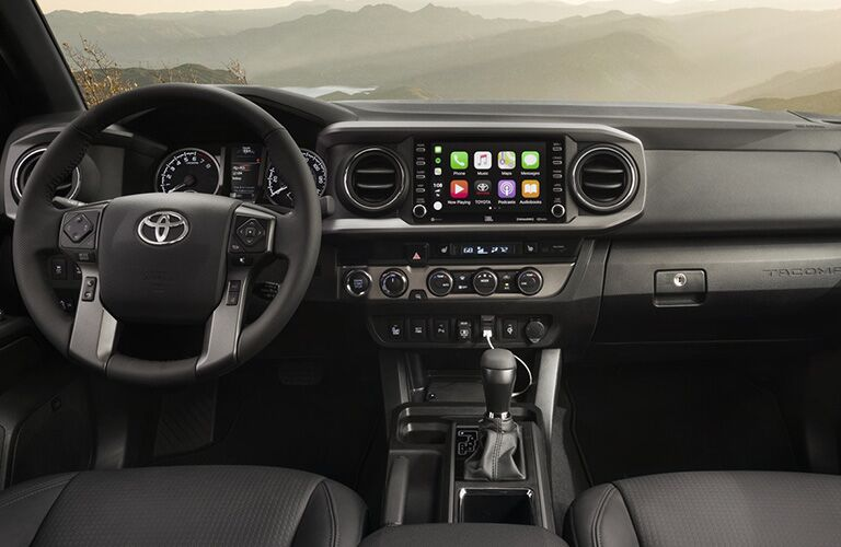 A front interior view inside a 2020 Toyota Tacoma.