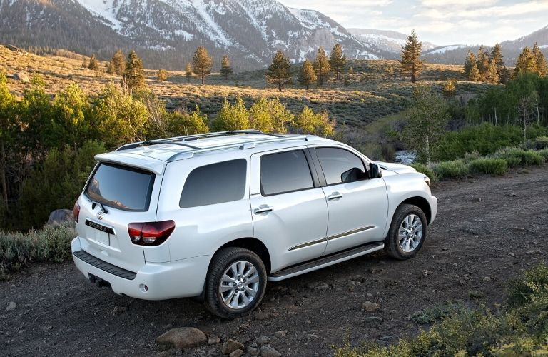 2020 Toyota Sequoia exterior passenger rear side seen from a higher view with mountains in the background
