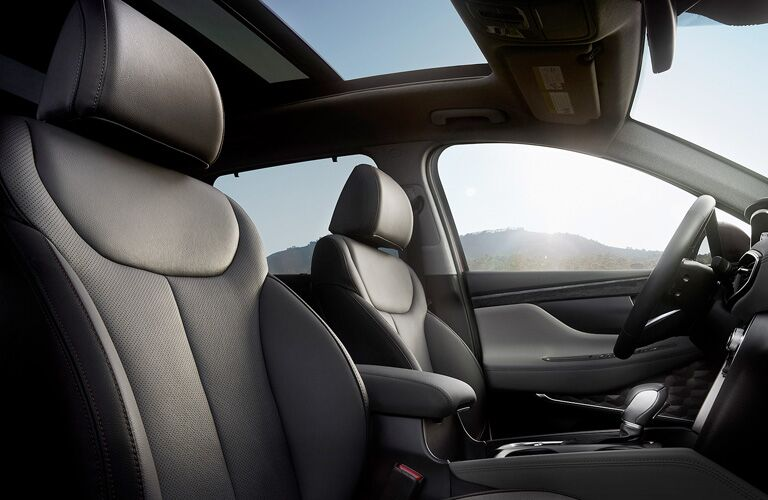 2020 Hyundai Santa Fe interior front cabin low view of seats and sunroof