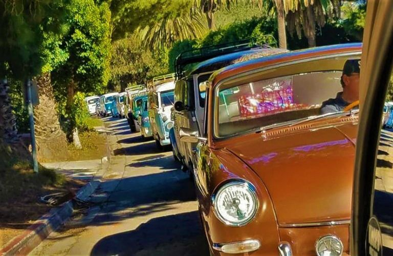 line of VW models delivering Christmas donations