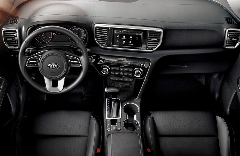 Interior view of the front seating area inside a 2020 Kia Sportage
