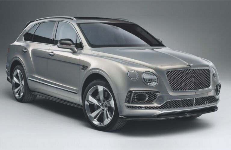 Silver 2019 Bentley Bentayga on a gray background