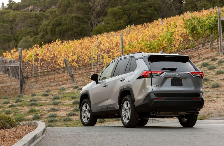 A rear photo of the 2021 Toyota RAV4 on the road.