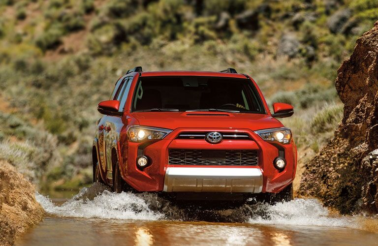 red 2020 Toyota 4Runner driving through water