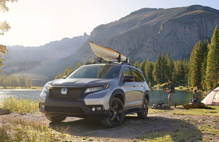 2020 Honda Passport Elite loaded with a kayak near a lake