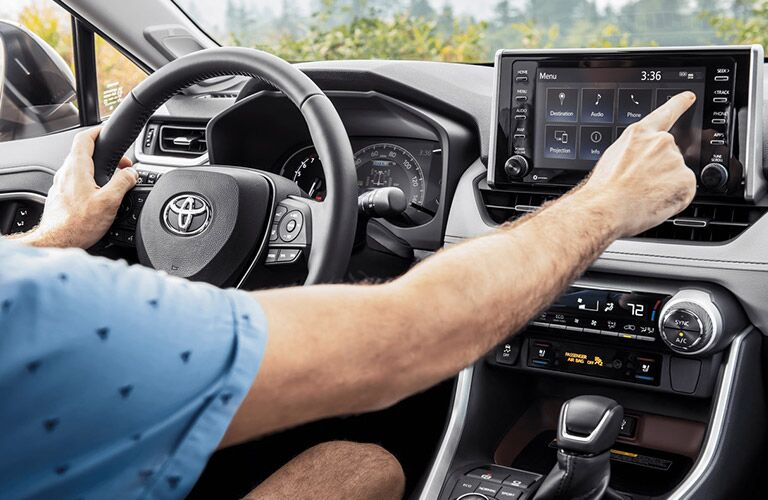 Interior of 2020 Toyota RAV4 with closeup of touchscreen and steering wheel