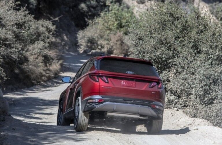 The rear view of a red 2022 Hyundai Tucson.