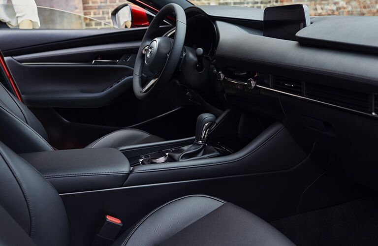 Front two seats and steering wheel of 2019 Mazda3