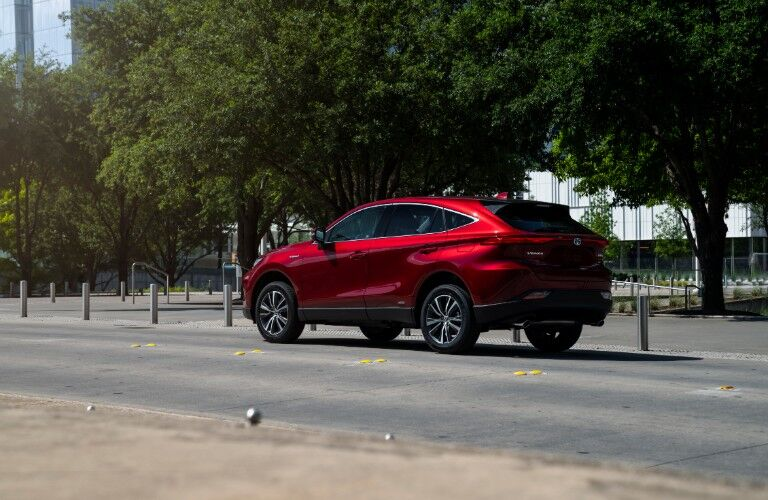 red 2021 Toyota Venza driving down a road