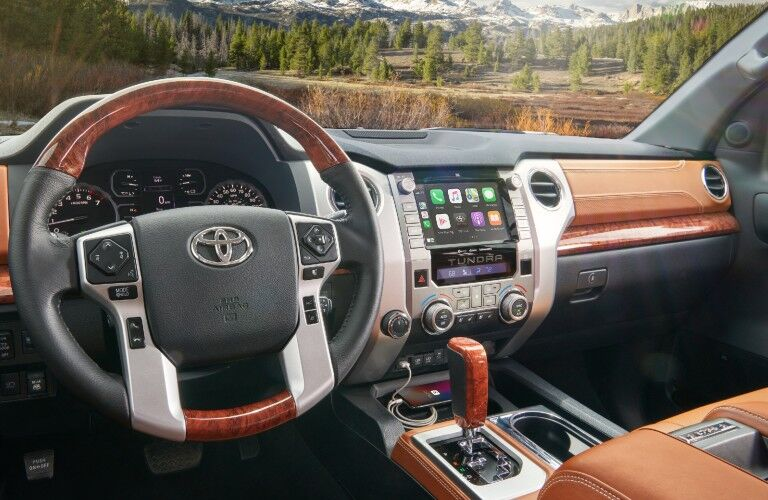 A photo of the driver's cockpit and dashboard in the 2021 Toyota Tundra.
