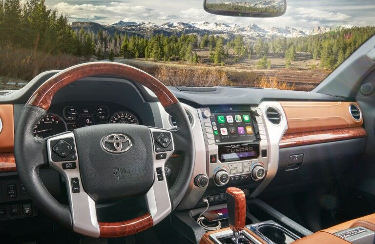 Interior view of the steering wheel and touchscreen display inside a 2020 Toyota Tundra