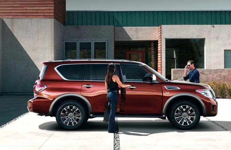 People getting inside of the Nissan Armada